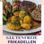 Teller mit Frikadellen, Kartoffeln und Speckbohnen auf weißem Teller.