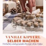 Hand greift nach Vanillekipferl auf Backrost