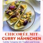 Topshot von Chicoree Schiffchen auf weißem Teller mit roten Trauben und Haselnüssen garniert