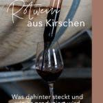 Rotwein wird aus großer Glaspipette in Weinglas gegossen